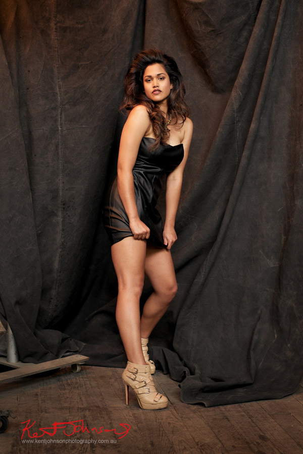 Full length shot, studio model portfolio shoot on black canvas background.