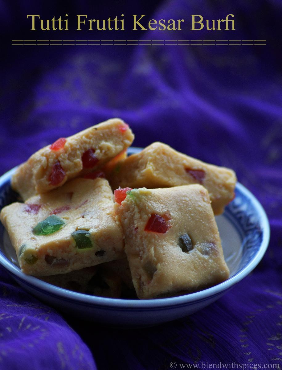 how to make tutti frutti saffron burfi recipe, holi special sweets recipes | blendwithspices.com