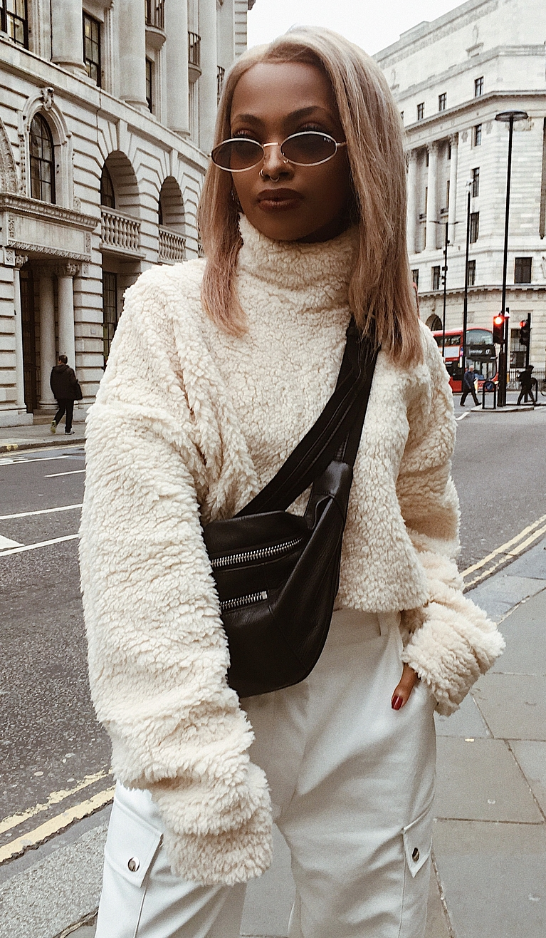 comfy outfit with a black bag_fur sweatshirt and white pants
