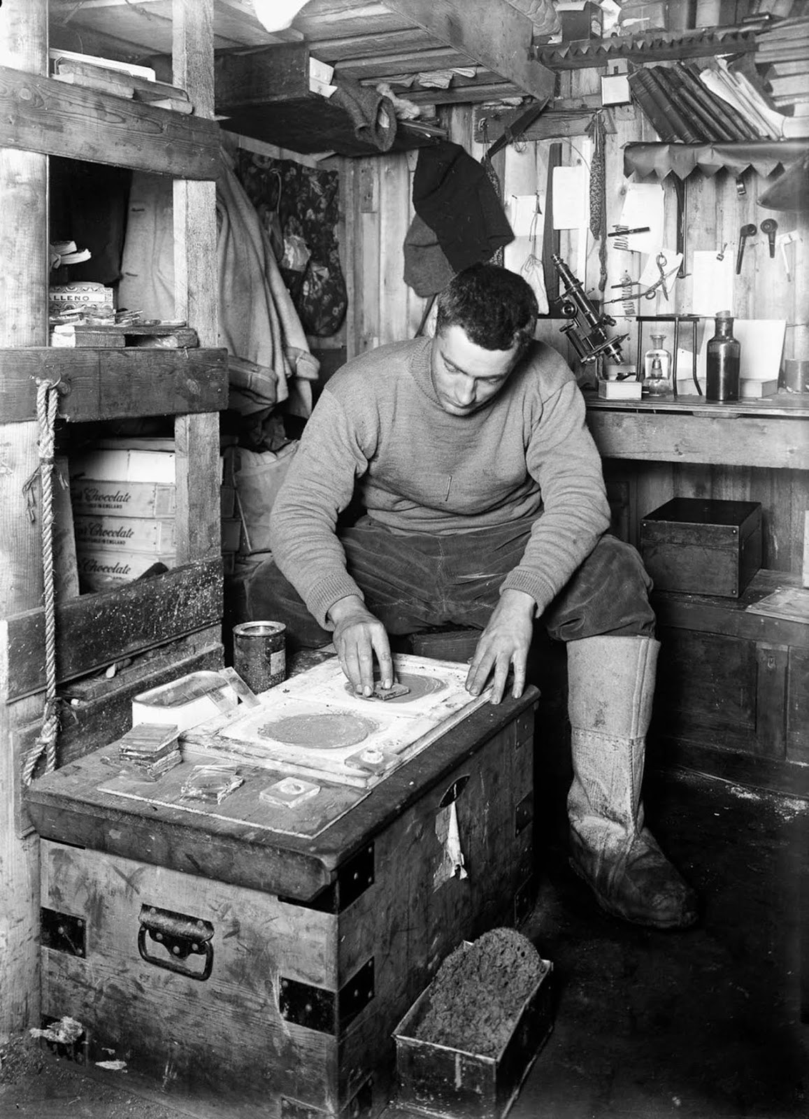Geologist Frank Debenham grinds stone samples. June 12, 1911.