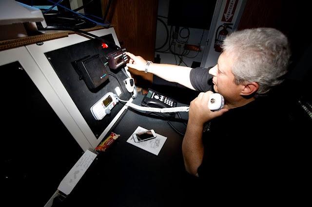 Auxiliarist Bob Daraio takes a watch at Station Shark River