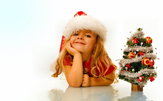 cute-kid-smiling-with-xmas-tree-HD-Christmas-wallpaper-image.jpg