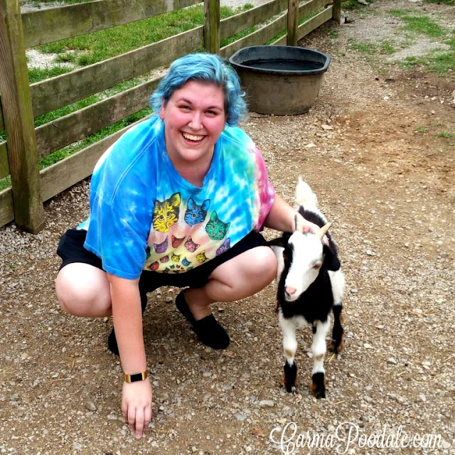 Sarah the kid with a baby goat a Kid