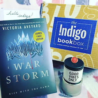 May's IndigoBookBox featuring War Storm by Victoria Aveyard.