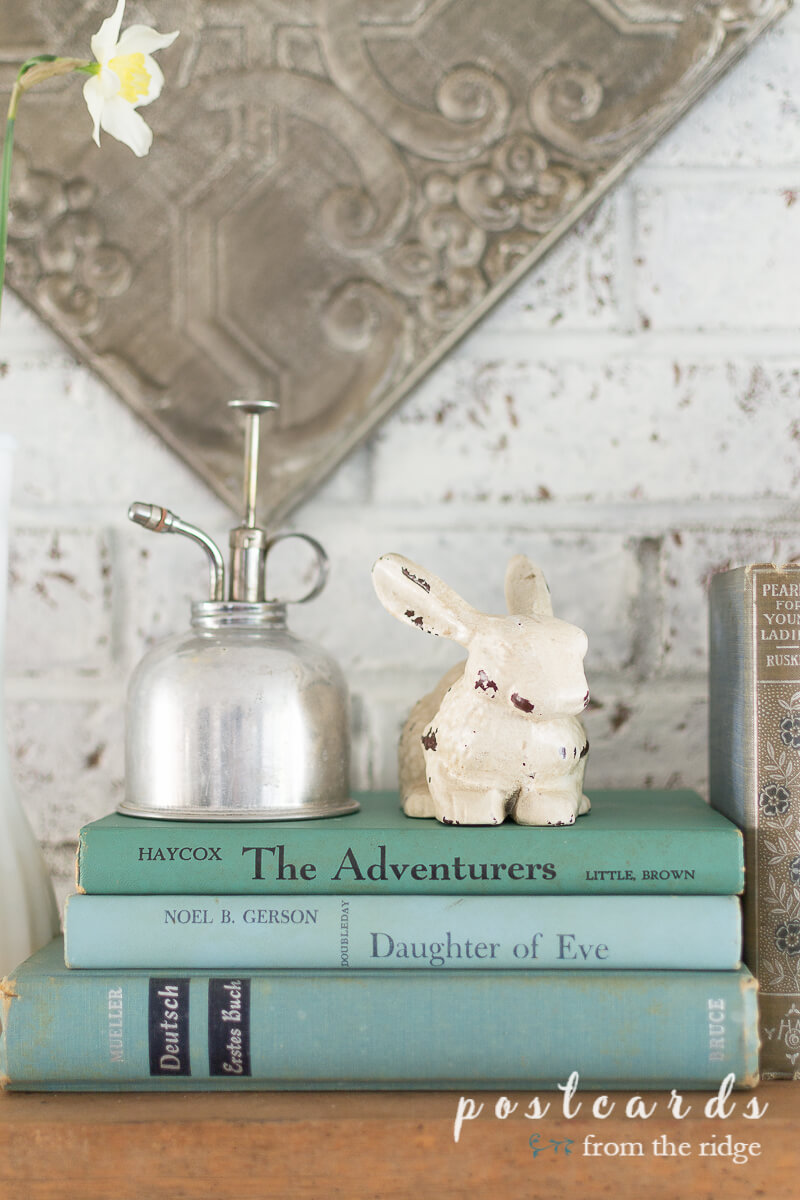 vintage books and cast iron bunny statue