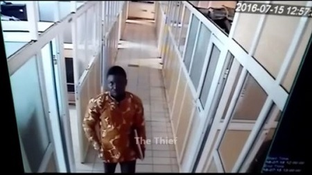 Shocking! Young Man Caught on Camera Stealing a Laptop from an Office in Abuja (Video)