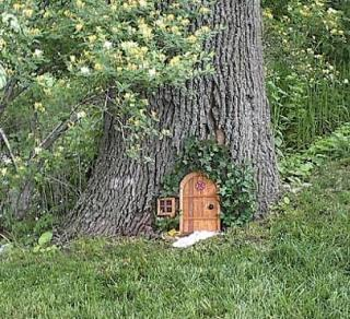Two men and a little farm future project fairy door in a for Gnome doors for trees