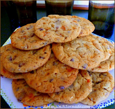 Crunchy Peanut Butter Suprise Cookies, a crunchy peanut butter cookie with mini chocolate chips and a few surprises inside | Recipe developed by www.BakingInATornado.com | #recipe #cookies #chocolate