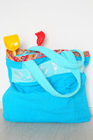 http://theseamanmom.com/towel-beach-bag-tutorial/