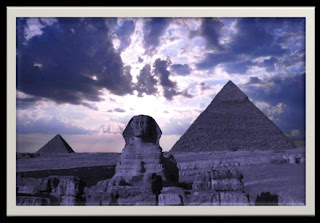 Sphinx in front of pyramids with moon behind in a purple sky- created by Barbara Ivie Green