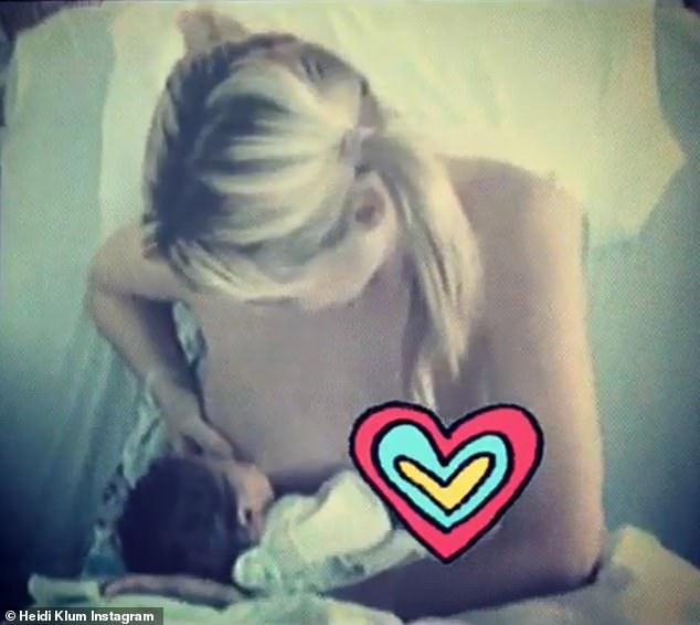 Heidi Klum poses a touching clip of herself breastfeeding Leni for the first time
