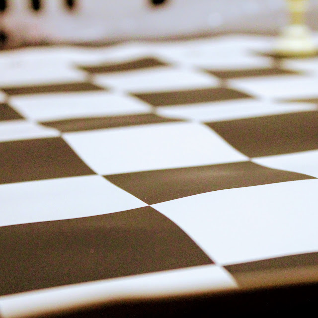 Tournament Roll-up Triple Weighted Chess Set - The vinyl chess board which is uneven when rolled out.