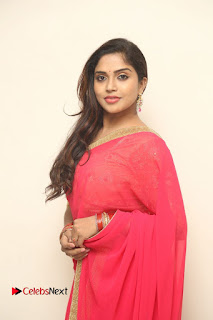 Actress Karunya Chowdary Pictures in Red Saree at Neerajanam Audio Launch  0090