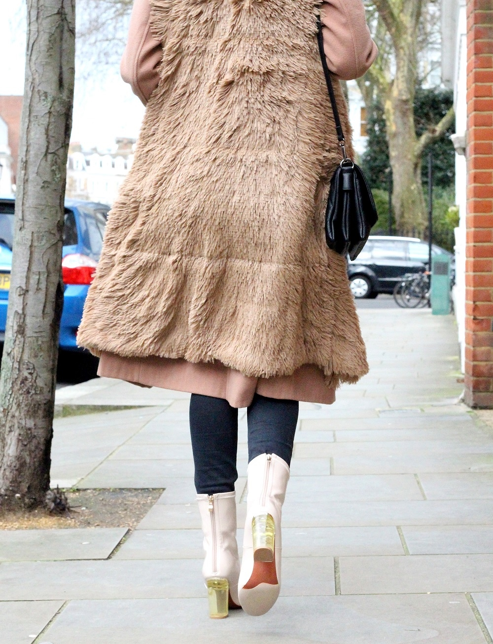 camel coat faux fur gilet perspex boots