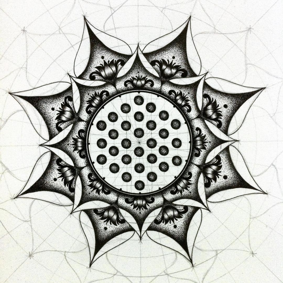 06-Eeling-Wong-Mandala-Drawings-Examples-of-Symmetry-and-Precision-www-designstack-co