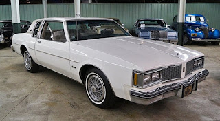 white Oldsmobile 2-Dr, 3/4 view