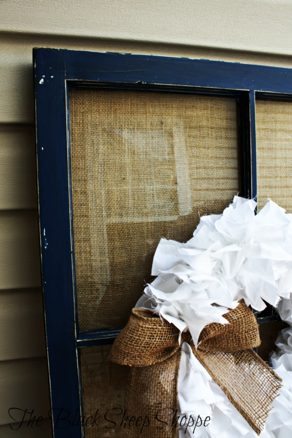 Adding burlap fabric and a wreath softens the overall look of the project.