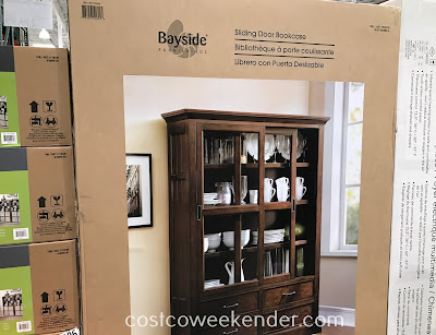 Store dinnerware, books, or vases in the Bayside Furnishings Sliding Door Bookcase