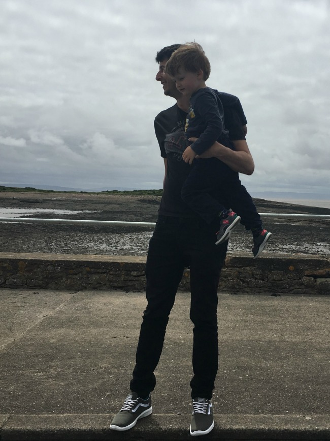 Our-weekly-journal-26th-June-2017-toddler-with-adult-in-silhouette-at-Swanbridge