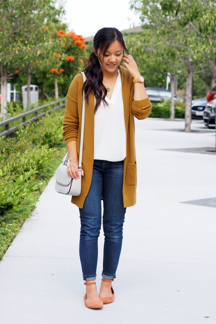 white top + brown cardigan + jeans + red flats