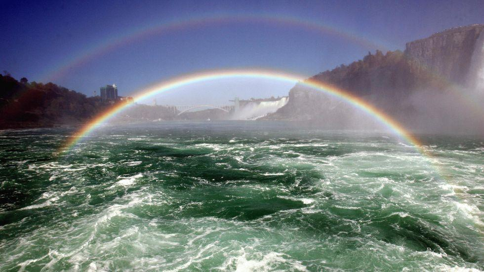 Niagara Falls are seen with a double rainbow on 8 October 2006, from aboard the Maid on the Niagara River.