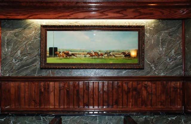 Framed Artwork in Restroom Trailer