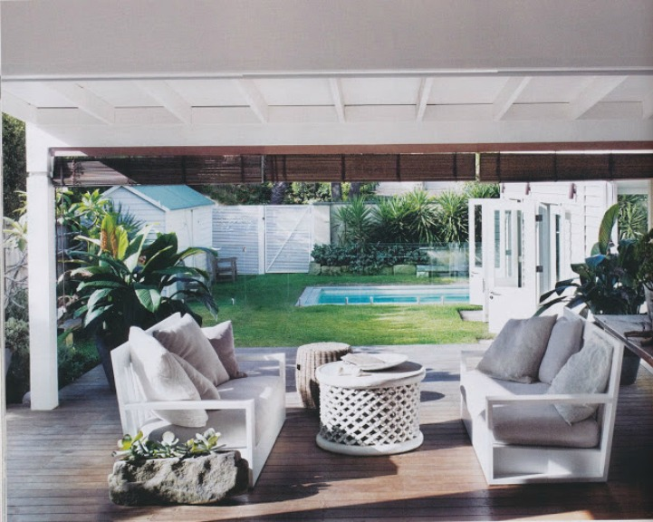 Coastal beach house outdoor space with low modern sofas