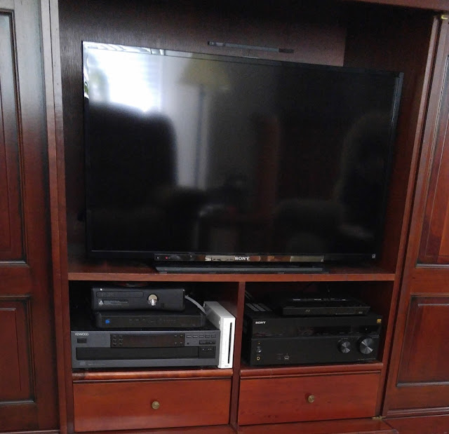 Gaming systems in entertainment center