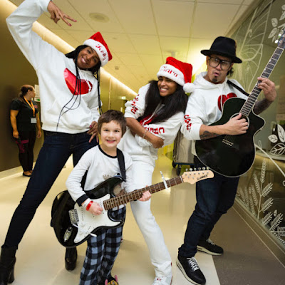 ciara and rowland visits the sick for christmas