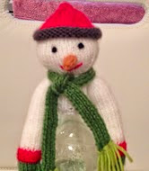 http://www.ravelry.com/patterns/library/snowman-bottle-topper