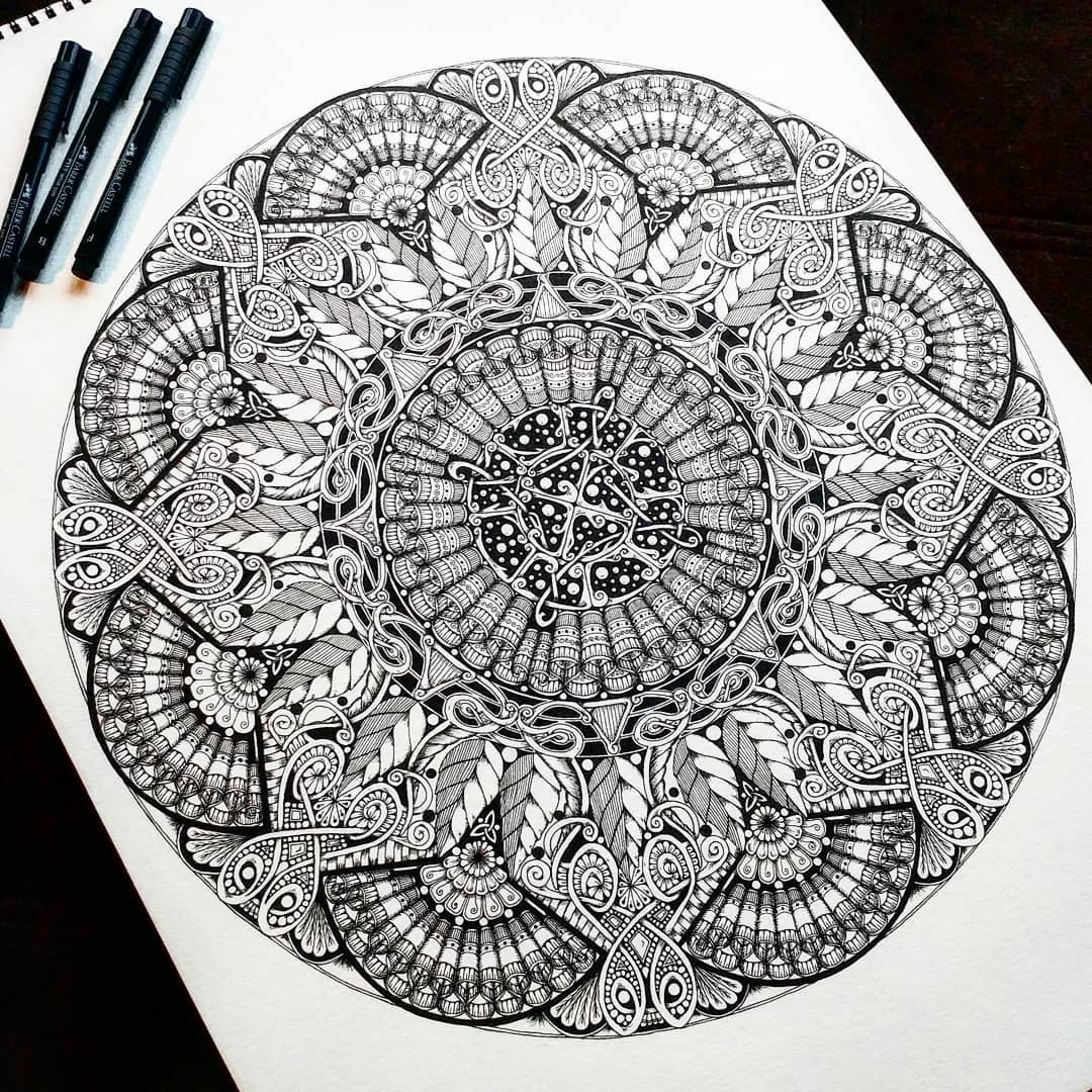 12-Jody-Romero-Symmetry-Balance-and-Harmony-in-Mandala-Drawings-www-designstack-co