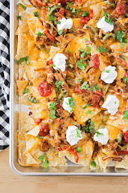 These chicken fajita nachos are so flavorful and delicious! They're perfect for game day or parties!