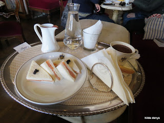 Silver tray with sandwich and hot chocolate at Florian's