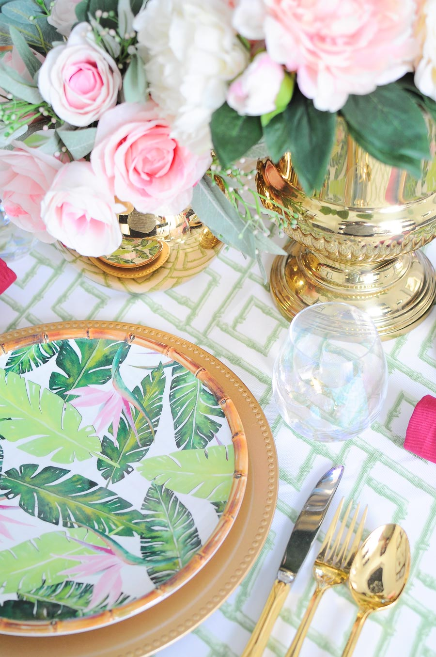 A Palm Beach and chinoiserie inspired table and centerpiece design for a small space.The bamboo, peonies and gold flatware are perfection.