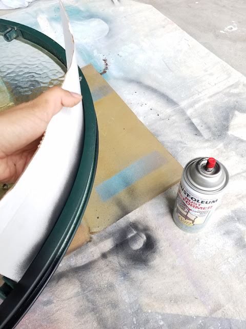 protecting a glass surface table from being spray painted