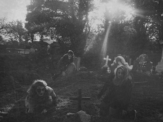 Three ghostly creatures lurking in a cemetery