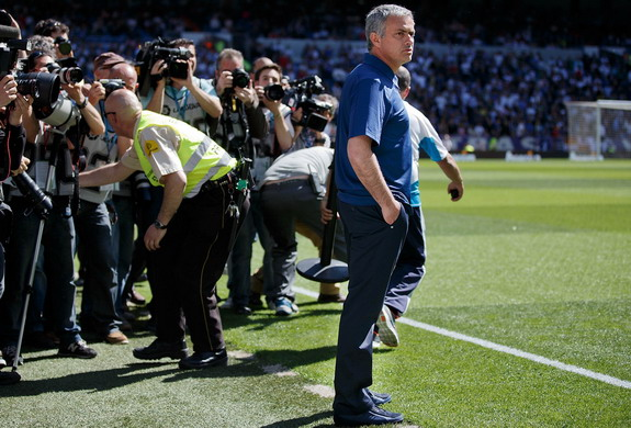 José Mourinho is surrounded by photographers in his final game as Real Madrid coach