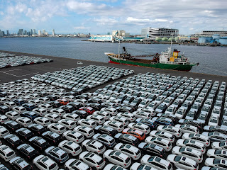 Lot of cars next to harbor