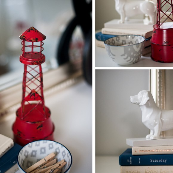 These decor accessories like the red light house and ceramic dog add cute details to the space.