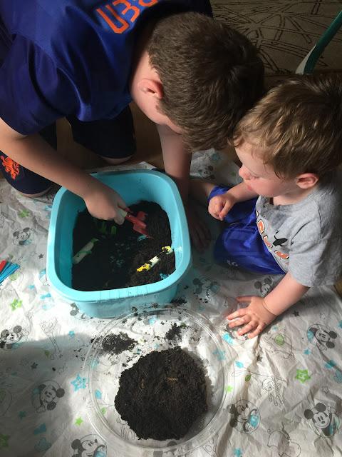 siblings playing in mud