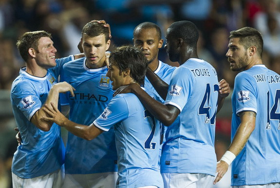 Edin Džeko is congratulated by Manchester City teammates after scoring a goal against Sunderland