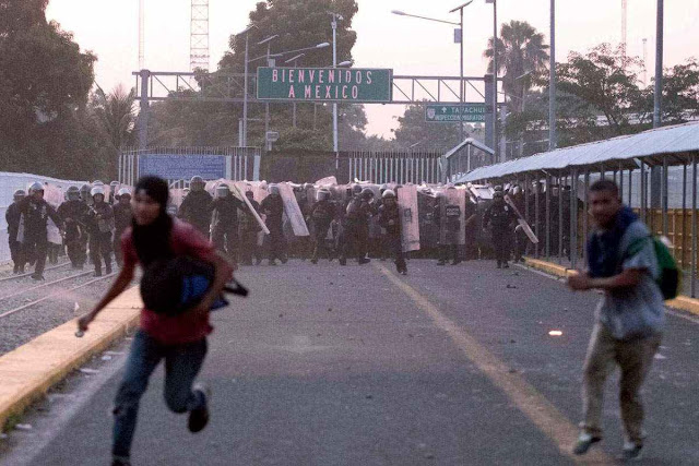 US-bound migrants cross into Guatemala, others clash at border