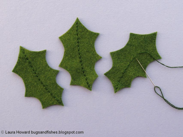 embroidering the holly leaves
