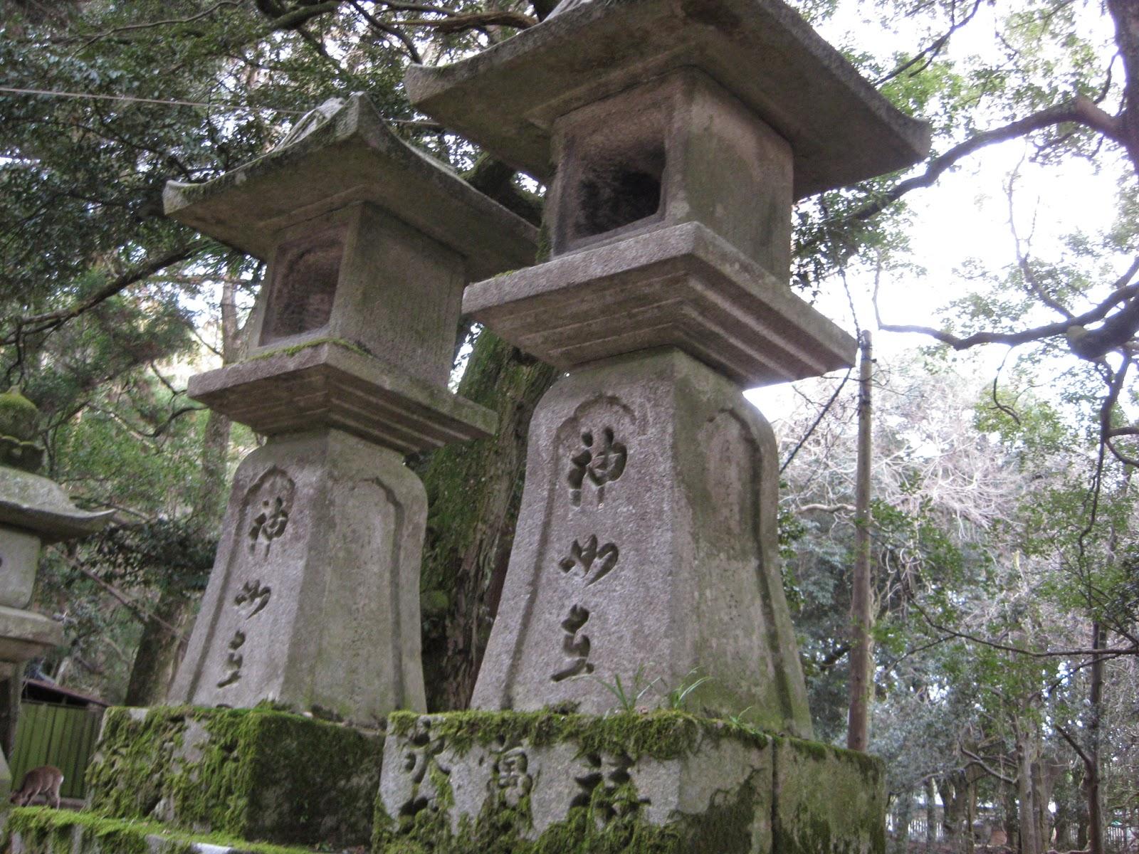 Kyoto - Stone temples line the pathway to Kasuga-taisha Shrine