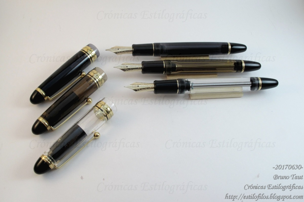 The Custom 823 in its three versions: smoke, amber, and clear (back to  front).