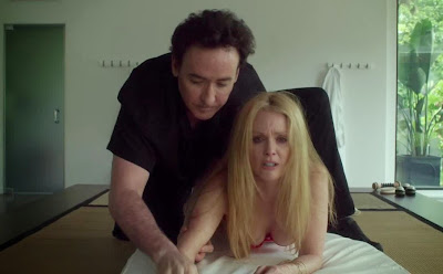 Julianne Moore as Havana, John Cusack as Dr. Stafford Weiss, giving new age therapy, in Maps to the Stars, Directed by David Cronenberg