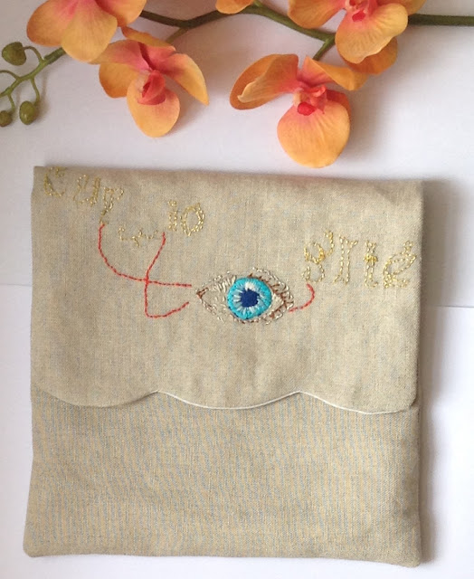 Embroidered eye on a pouch