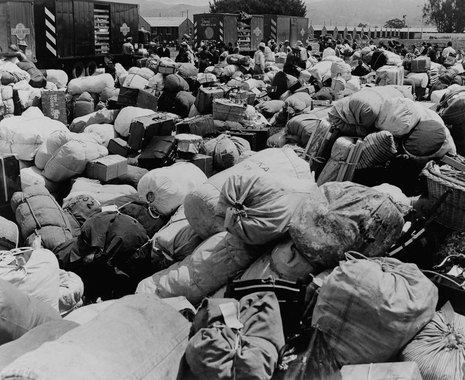 Evacuees' baggage is piled up for transport at an assembly center in Salinas, California.
