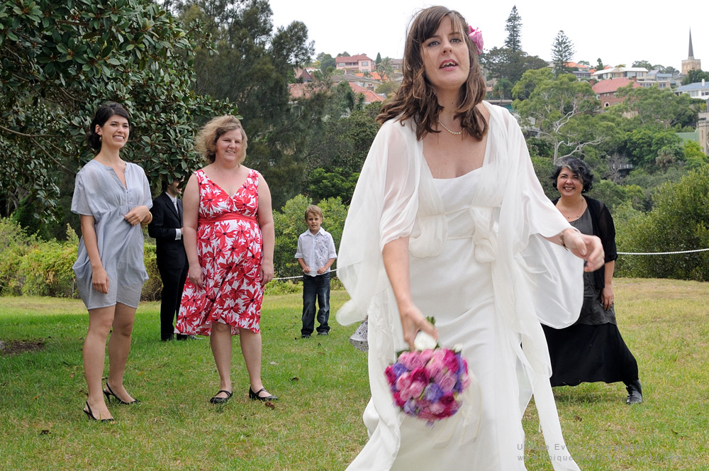 Throwing the brides bouquet, only one can win! Unique event photography Sydney