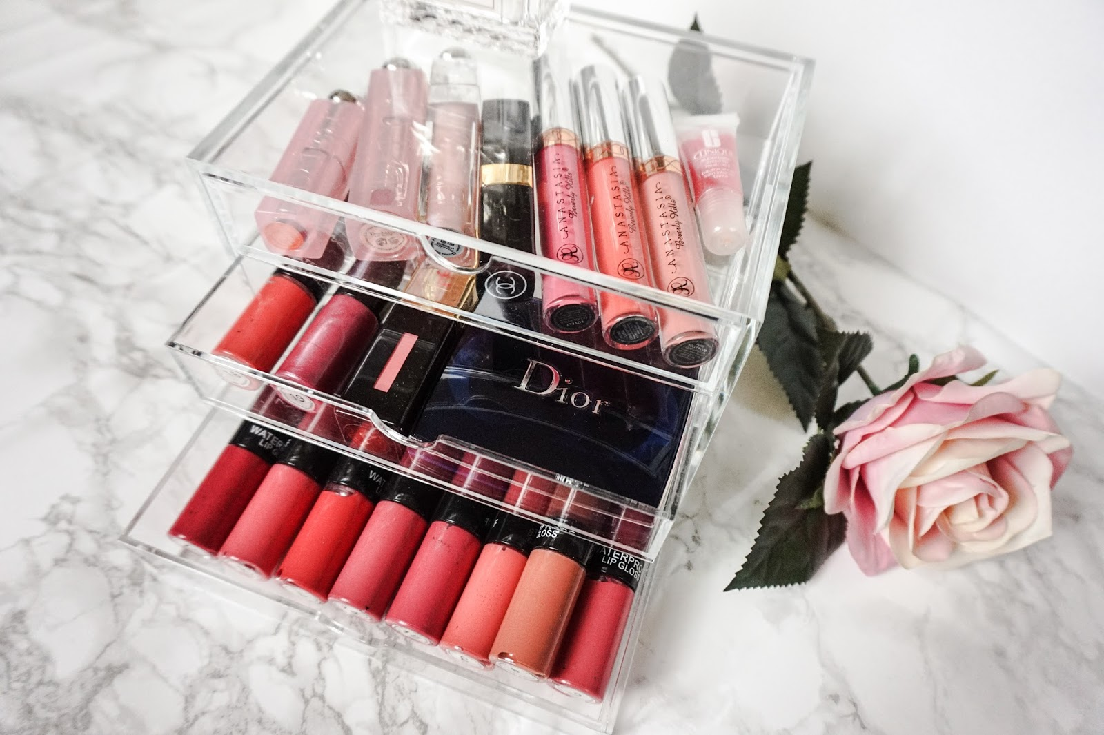 Medium acrylic storage box with lip products